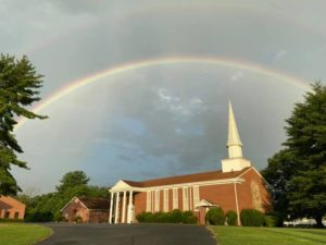 Cartersville church of Christ building with rainbow